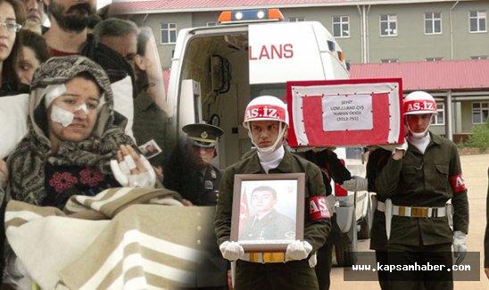 Şehit Öksüz'ü, saldırıda yaralanan hamile eşi sedyede uğurladı