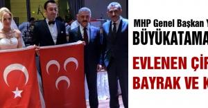 MHP#039;li Büyükataman Evlenen çifte Bayrak ve Kur#039;an...