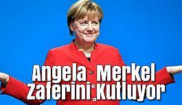 Angela  Merkel Zaferini Kutluyor