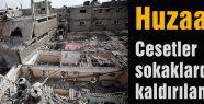 Huzaa'da Cesetler sokaklarda kaldı