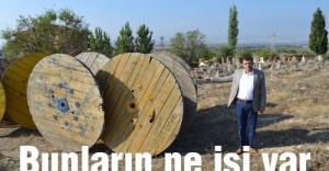MHP'li Öztürk: Mezarlığın içinde kablo makaralarının işi ne?